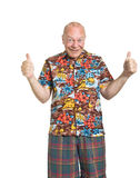 Senior on Holiday. Expressive old man in loud shirt holiday concept isolated against white Stock Photography