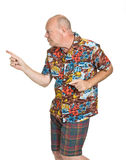 Senior on Holiday. Expressive old man in loud shirt holiday concept isolated against white Royalty Free Stock Photography