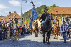 Senior horseman holding flag during Brasov Juni parade Royalty Free Stock Photos