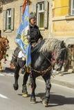 Senior horseman holding flag Royalty Free Stock Images