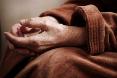 Senior in hospital gown. Hands of old woman ,conceptual photo about problems of golden age, selective focus Royalty Free Stock Photo