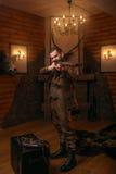 Senior hunter aims of the antique shotgun Royalty Free Stock Photography