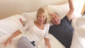 Senior husband and wife jump