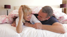 Senior husband and wife snuggled  Royalty Free Stock Photos