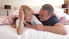 Senior husband and wife snuggled