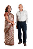 Senior Indian couple. A senior Indian / Asian couple standing - isolated on white Royalty Free Stock Image