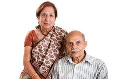 Senior Indian couple. A senior Indian / Asian couple - isolated on white Royalty Free Stock Photo