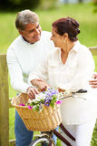 Senior Indian Couple On Cycle Ride In Countryside Royalty Free Stock Photos