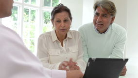 Senior Indian Couple Meeting With Financial Advisor At Home stock video