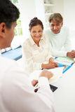 Senior Indian Couple Meeting With Financial Advisor At Home stock images
