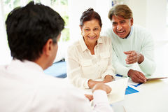 Senior Indian Couple Meeting With Financial Advisor At Home Royalty Free Stock Image