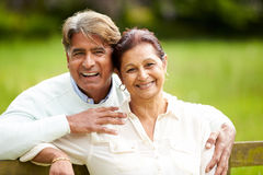 Senior Indian Couple Walking In Countryside. Looking At Camera Smiling Stock Photos