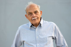 Senior Indian Man. A senior Indian / South Asian man against a light blue background Royalty Free Stock Photo
