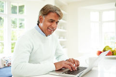Senior Indian Man Using Laptop At Home Royalty Free Stock Image