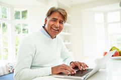 Senior Indian Man Using Laptop At Home Stock Photography