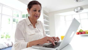 Senior Indian Woman Using Laptop Computer At Home Royalty Free Stock Photos
