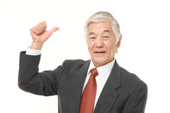 Senior Japanese business man pointing at his back Stock Photos