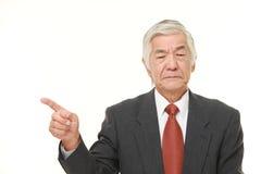 Senior Japanese businessman doubting Stock Image
