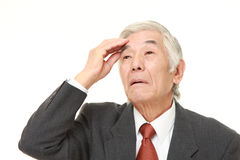 Senior Japanese businessman has lost his memory Royalty Free Stock Image