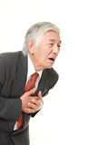 Senior Japanese businessman heart attack Stock Image
