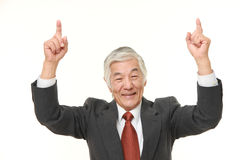 Senior Japanese businessman pointing up Royalty Free Stock Image