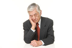 Senior Japanese businessman sleeping on the table Stock Photo