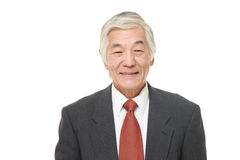 Senior Japanese businessman smiles Stock Image