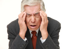 Senior Japanese businessman suffers from headache Stock Photography