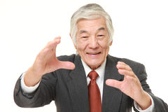 Senior Japanese businessman with supernatural power Royalty Free Stock Photography