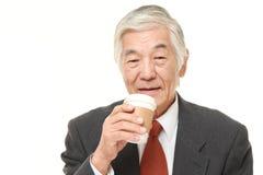 Senior Japanese businessman takes a coffee break Stock Photo