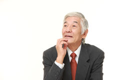 Senior Japanese businessman thinks about something Royalty Free Stock Photography