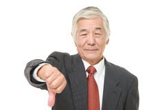 Senior Japanese businessman with thumbs down gesture Stock Images