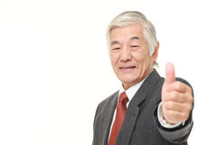 Senior Japanese businessman with thumbs up gesture Royalty Free Stock Photography