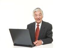 Senior Japanese  businessman using laptop computer Royalty Free Stock Photography