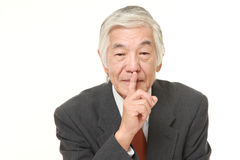 Senior Japanese businessman whith silence gestures Stock Images