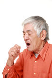 Senior Japanese man coughing stock image