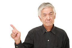 Senior Japanese man doubting royalty free stock photo