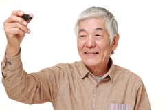 Senior Japanese man draw in the air Stock Image