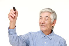 Senior Japanese man draw in the air Royalty Free Stock Photo