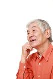 Senior Japanese man dreaming at his future  Royalty Free Stock Images