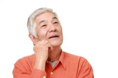 Senior Japanese man dreaming at his future  Royalty Free Stock Image