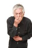 Senior Japanese man feels like vomiting Stock Image
