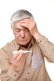 Senior Japanese man with fever Royalty Free Stock Images