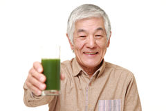 Senior Japanese man with green vegetable juice Royalty Free Stock Images