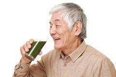 Senior Japanese man with green vegetable juice Royalty Free Stock Image