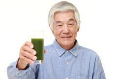 Senior Japanese man with green vegetable juice Stock Photo