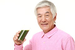 Senior Japanese man with green vegetable juice Stock Images