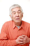 Senior Japanese man heart attack Royalty Free Stock Images