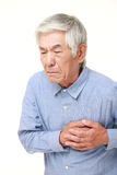 Senior Japanese man heart attack Royalty Free Stock Photography