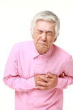 Senior Japanese man heart attack Royalty Free Stock Images